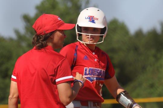 Louisiana Tech sophomore Lindsay Edwards takes instruction from new head coach Maria Winn-Ratliff.