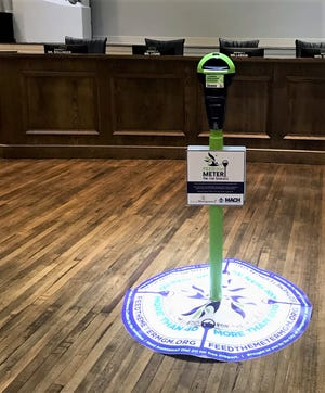 Mayor Steven Reed announced the Feed the Meter for the Homeless program at a recent City Council meeting.