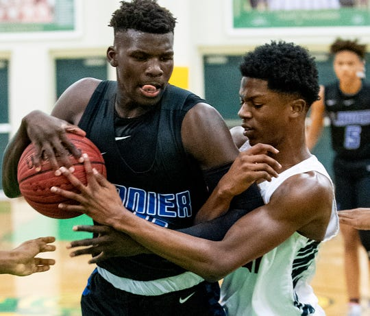 Lanier's Antwan Burnett (11) and Park Crossing's Zac'cai Armstrong (12) fight for the ball in Class 6A, Area 4 tournament action at Carver High School in Montgomery, Ala., on Wednesday February 5, 2020.
