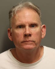 Michael Bradley, 57, was arrested Wednesday, Feb. 5, charged with with one count of a school employee having sexual contact with a student under the age of 19 and second-degree sexual abuse.