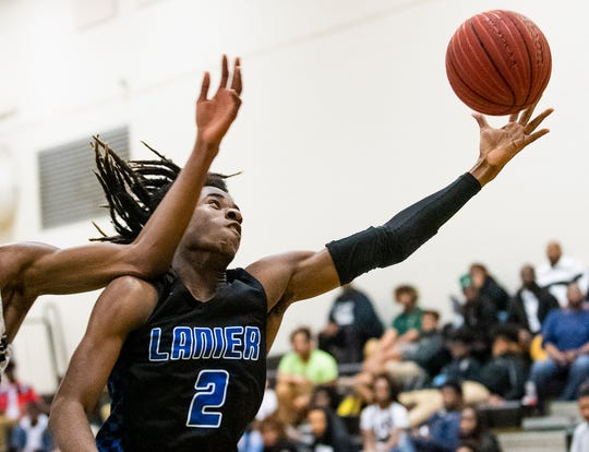 Lanier's Juan Brown (2) grabs a rebound against Park Crossing in Class 6A, Area 4 tournament action at Carver High School in Montgomery, Ala., on Wednesday February 5, 2020.
