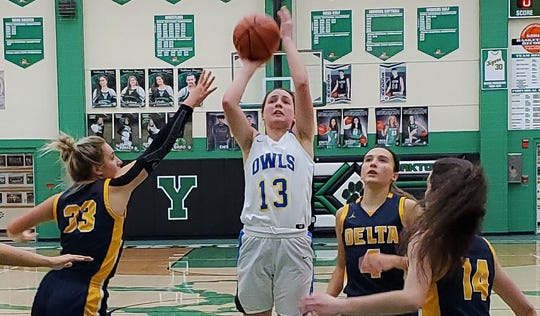Burris' Emily Adamowicz shoots past Delta's defense during their sectional first round game at Yorktown High School on Feb. 5, 2020.