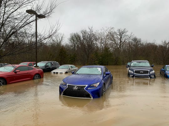 Several cars parked at the Toyota of Murfreesboro dealership were rushed by water from a nearby creek, which swelled due to rain Wednesday night.