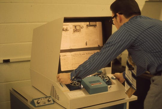 Library Dean Don Craig uses the microfilm reader in the Todd Library in this file photo from the 1980s.
