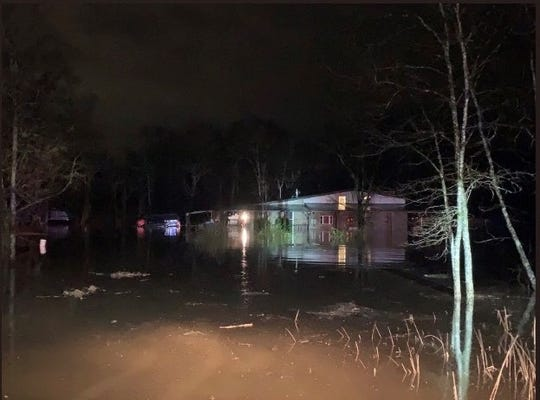 Rutherford County Fire Rescue personnel assisted three people and a dog to leave their home after heavy rains Wednesday flooded the ground floor of their Rockvale home.