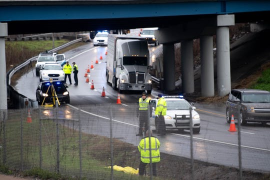 Authorities investigate a body found along Interstate 40 Thursday, Feb. 6, 2020, in Nashville, Tenn.