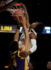 Vanderbilt guard Saben Lee (0) dunks over LSU guard Skylar Mays (4) during the second half at Memorial Gym Wednesday, Feb. 5, 2020 in Nashville, Tenn. Vanderbilt defeated LSU 99 to 90.