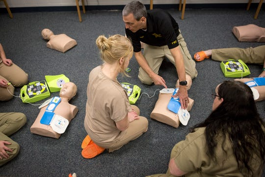 Deputy Greg Cook teaches inmates at the Licking County Justice Center how to use an AED machine during a course teaching CPR skills. By the end of the course each participant will be tested to be certified. The class also teaches how to help someone who is choking, first aid skills as well as how to administer Naloxone.
