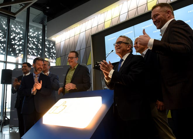 "Licking Heights Local Schools Superintendent Philip Wagner, Facebook Director of Data Center Operations Mike Reffle, Governor Mike DeWine and New Albany Mayor Sloan Spalding light the ""Like"" sign during the grand-opening of the Facebook Data Center on Thursday, Feb. 6, 2020."