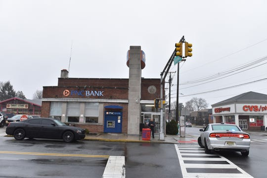Police surround the PNC Bank after a bank robbery on the corner of Boadway and Van Houten Ave in Passaic, N.J. on Thursday Feb. 6, 2020.
