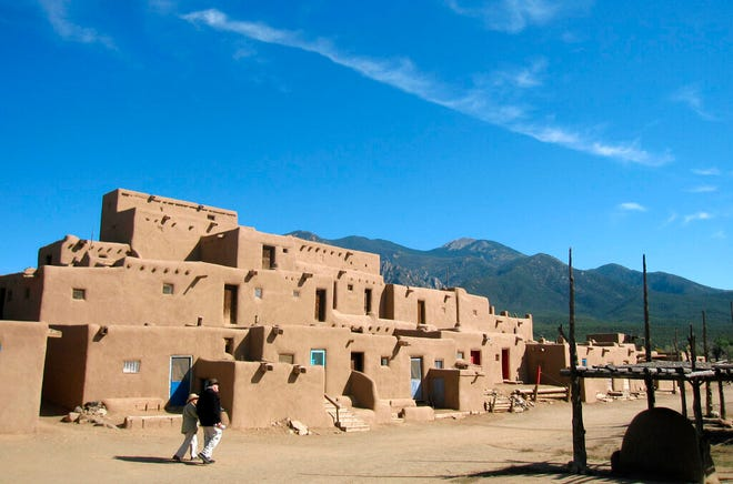 In this October 2012 file photo, adobe dwellings at the Taos Pueblo are seen in Taos. The story of the return of Blue Lake and 75 square miles of surrounding national forest land to the people of Taos Pueblo, finalized with President Richard Nixon's signature in December 1970, is being retold 50 years later, as tribal leaders and state legislators look for ways to preserve documentation and memories of the landmark victory for indigenous rights.