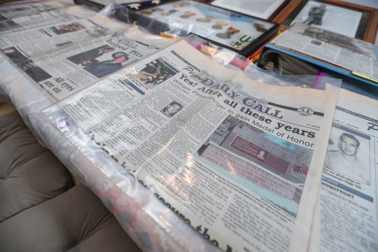 "A collection of memorabilia is displayed on the dining room table at the Las Cruces home of John Pittsenbargar in Las Cruces on Thursday, Feb. 6, 2020. Pittsenbargar's cousin, William Hart Pitsenbarger, is the subject of a new movie called ""The Last Full Measure."""