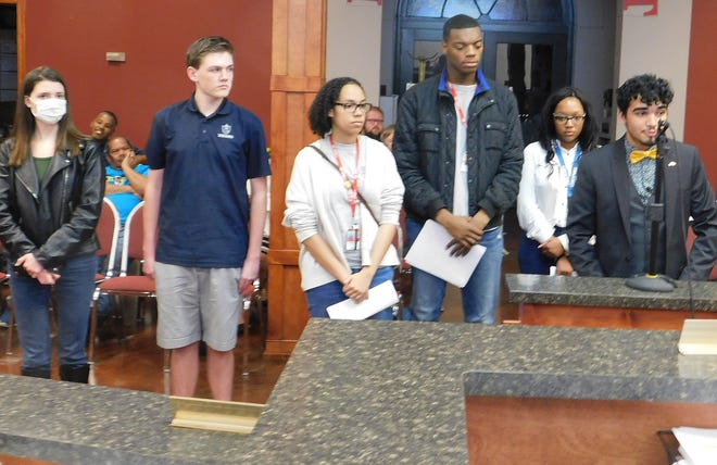 Eduardo Ramirez of Opelousas High speaks to the St. Landry Parish Council about expanding recycling. Appearing before the council along with Ramirez are, from right to left, fellow students Amy Cavell, Justin Shankle, Sedonia Davis, Tyrese Pickney and Kennedy Dejean.