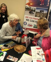 Volunteers share information on how to be prepared in the event of a disaster.