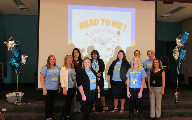 Some of the members of the Elementary Literacy Committee with RCOE's Dr. Felicia Cruz-Delgado, third from left; and Bubbling Wells Elementary Principal Jennifer Geyer, fourth from left.