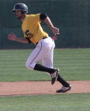 Javier Lopez plays for the British Columbia Bombers in the California Winter League. In this photo he is seeing playing a game against the Palm Springs Power team in Palm Springs. His father played in Major League Baseball.