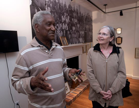 """Ellis Jones and Lee Hansen review plans Thursday for the upcoming 100th birthday celebration for Gen. Daniel """"Chappie"""" James Jr. during a meeting at the Chappie James Museum in downtown Pensacola."""