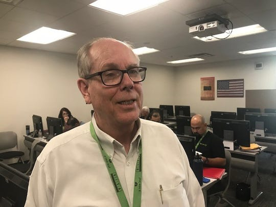 Jim Simpson, a certified public accountant, oversees a free tax-return preparation site at Scottsdale Community College.