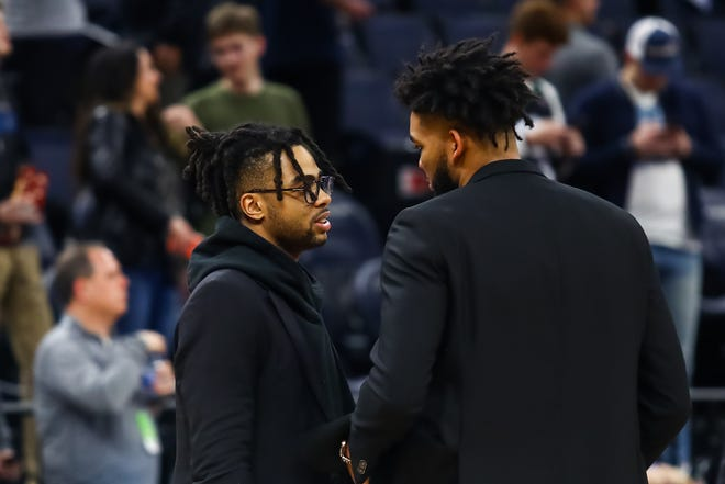 Golden State Warriors guard D'Angelo Russell (left) and Minnesota Timberwolves center Karl-Anthony Towns (right) talk after a game at Target Center earlier this season. The two are now teammates in Minnesota.