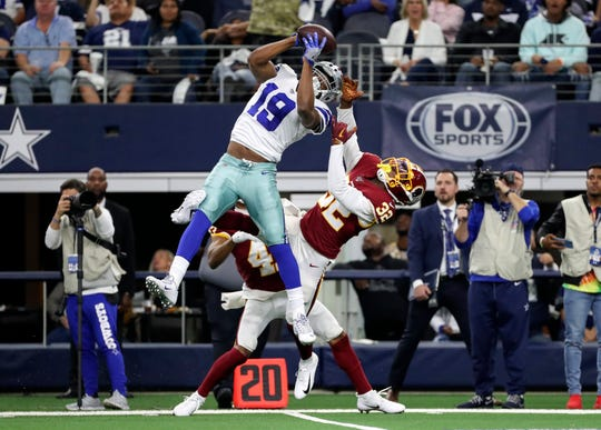 Dallas Cowboys wide receiver Amari Cooper (19) makes a leaping catch against Washington Redskins cornerback Jimmy Moreland (32) during the second quarter at AT&T Stadium.