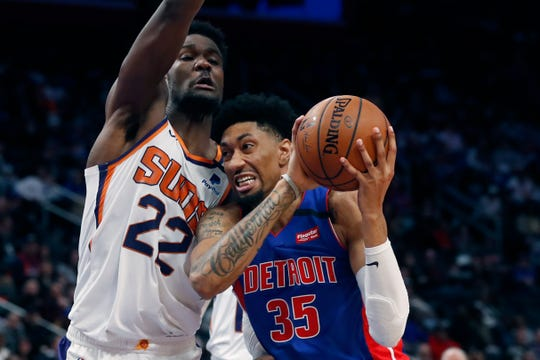 Detroit Pistons forward Christian Wood (35) runs into Phoenix Suns center Deandre Ayton (22) during the second half of an NBA basketball game, Wednesday, Feb. 5, 2020, in Detroit. (AP Photo/Carlos Osorio)