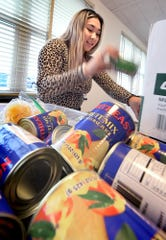 "York Suburban High School senior Tara Vo sorts canned goods during the Impact Foundation's ""Food for Thought"" program Luther Memorial Lutheran Church Thursday, Feb. 6, 2020. The Impact Foundation is a student-run organization. The collected food is delivered to area schools to provide children in need food over weekends. Bill Kalina photo"
