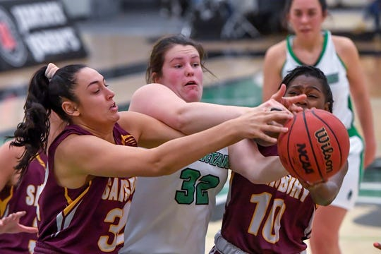 Salisbury's Courtney Brigham, left, and Dalina Julien battle with Molly Day of York College for a reboundl, Wednesday, February 5, 2020.John A. Pavoncello photo