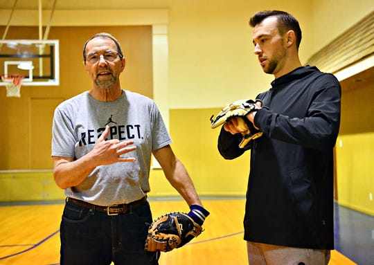 Wayne Lawrence, of McSherrystown, left, talks about catching with his son Casey Lawrence, of Hanover, inside the gym at Knights of Columbus in McSherrystown, Thursday, Feb. 6, 2020. Casey Lawrence, 32, will be leaving in mid February for spring training with the Minnesota Twins. Dawn J. Sagert photo