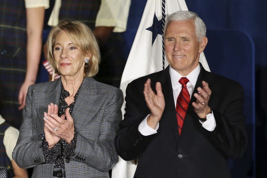 Secretary of Education Betsy DeVos, left, and Vice President Mike Pence applaud after speaking at St. Francis de Sales School in West Philadelphia on Wednesday, Feb. 5, 2020. Pence and DeVos were at the school for an event about school choice. (Tim Tai/The Philadelphia Inquirer via AP)