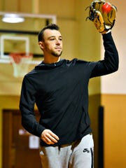 Athlete Casey Lawrence plays catch with his father inside the gym at Knights of Columbus in McSherrystown, Thursday, Feb. 6, 2020. Lawrence will be leaving in mid February for spring training with the Minnesota Twins. Dawn J. Sagert photo
