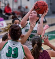 York College's Bradi Zumbrum goes up and over Salisbury defenders for a rebound, Wednesday, February 5, 2020.John A. Pavoncello photo