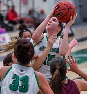 York College's Bradi Zumbrum goes up and over Salisbury defenders for a rebound, Wednesday, February 5, 2020.