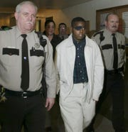 Andre Thomas is escorted out of the Grayson County Courthouse in 2005 during the sentencing phase of his murder trial. A decade-and-a-half after that Sherman jury sentenced him to die, Thomas talks to his lawyers about getting out of prison, getting his eyes back and going for a drive in the old car he tinkered with obsessively as a teen.