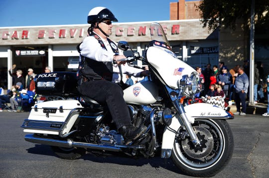 Retired San Angelo police officer Brian Bylsma rides the Sgt. Korby Kennedy memorial motorcycle during the San Angelo Stock Show and Rodeo parade Saturday, Feb. 1, 2020.
