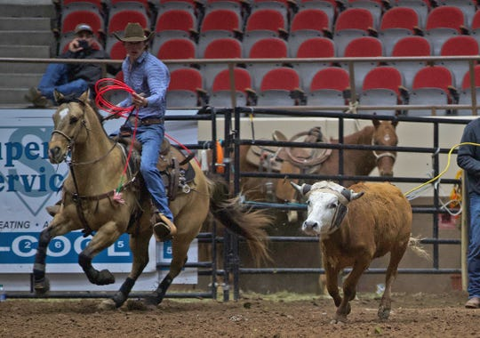 Truman Magnus, far left, competes in the team roping event at the San Angelo Stock Show and Rodeo on Tuesday, Feb. 4, 2020.