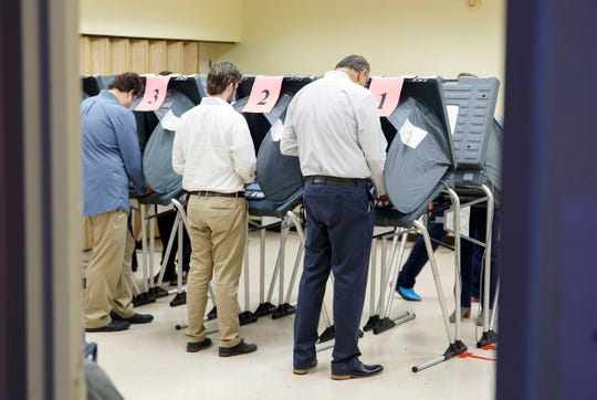 Voters cast their ballots at the Metropolitan Multi-Service Center in Houston.