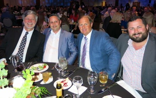 At Healers: Dr. David Lewis, dean of LSU Medical School, Matthew St. Amant, Chris Mudd and Cody Cloud at the MST Consulting, Southeast Dental Rehabilitation Services of Louisiana Table.