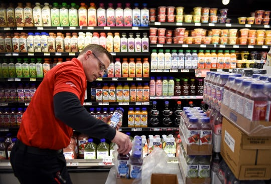 Produce and delivery worker Brian Binft stocks shelves on Thursday, Feb. 6, 2020 at the Hy-Vee on Minnesota Avenue. Hy-Vee recently announced a change in their stores hours and will no longer be open 24 hours.