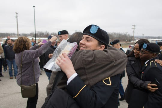 Pfc. Kaitlyn Castro hugs her father after graduating Basic Combat Training Jan. 30. She is now attending Advanced Individual Training at Joint Base San Antonio, Texas.