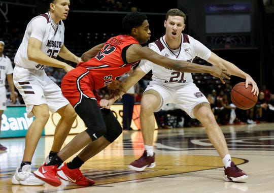 Ross Owens, of Missouri State, protects the ball as the Bears defeated the Illinois Redbirds 80-60 at JQH Arena on Wednesday, Feb. 5, 2020.