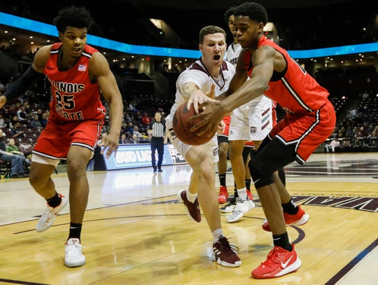 Ross Owens, of Missouri State, and Antonio Reeves, of Illinois State, go after the loose ball during their game at JQH Arena in Springfield, Mo., on Wednesday, Feb. 5, 2020.