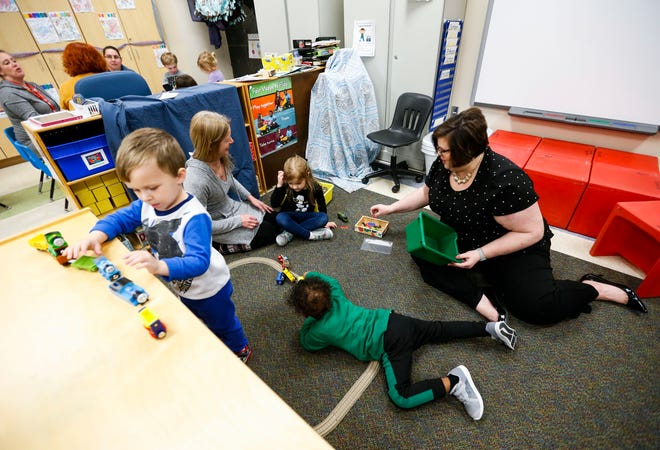 Christy Davis, the new director of early childhood education and Parents As Children, interacts with preschool children in February 2020.