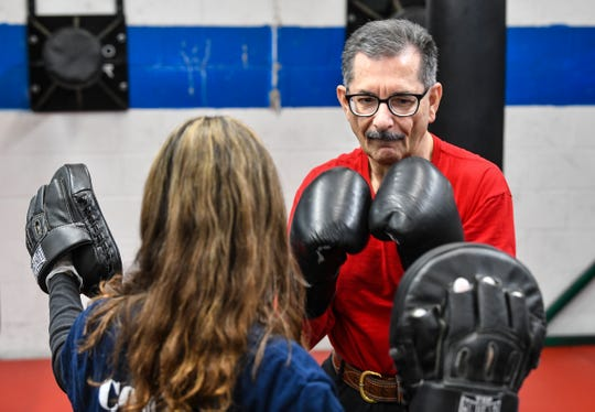 Joe Mehr works with instructor GraceMarie Tellone during a Rock Steady Boxing program class Wednesday, Feb. 5, 2020, at Downtown Gym & Fitness in St. Cloud. The program is designed to help people with Parkinson's disease.