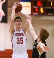 St. John's senior Lucas Walford takes a jump shot in the first half against St. Olaf Wednesday, Feb. 5, 2020, at Sexton Arena.