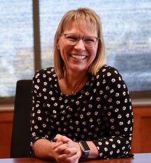 Melinda Gau, CEO of Quinlivan & Hughes, smiles during an interview Thursday, Feb. 6, 2020, at Quinlivan & Hughes.