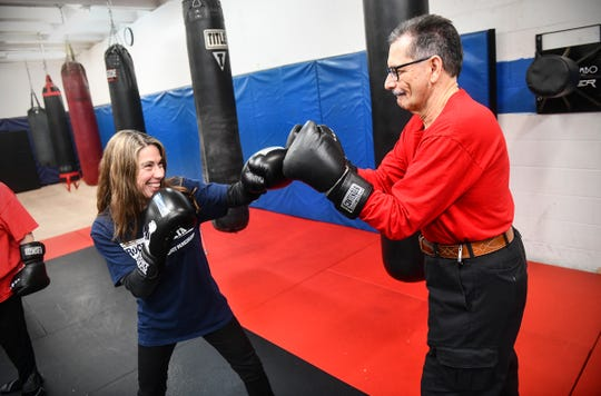 Instructor GraceMarie Tellone works with Joe Mehr during a Rock Steady Boxing class Wednesday, Feb. 5, 2020, at Downtown Gym & Fitness in St. Cloud.