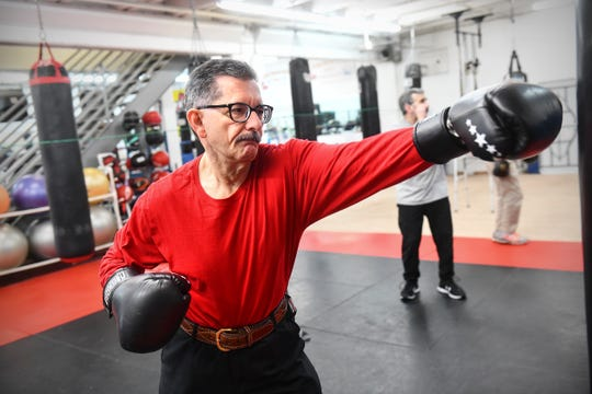 Joe Mehr works through an exercise during a Rock Steady Boxing class Wednesday, Feb. 5, 2020, at Downtown Gym & Fitness in St. Cloud.