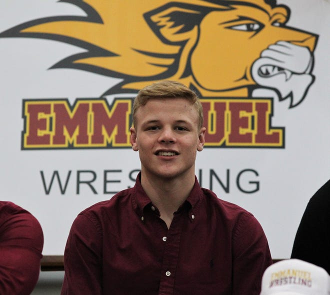 Florida High senior Brooks Dyer became the first wrestler in school history to sign a college scholarship when he inked with Division II Emmanuel College on Feb. 5, 2020.