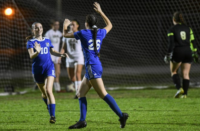 Emma Johnson of Martin Co. celebrates a goal with Emilee Moberg during Wednesday's Class 4A District 11 girls soccer semifinal against Viera.