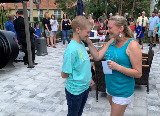 Amanda Elmer tells her daughter Brieanna that Make-A-Wish foundation has given the family tickets to SeaWorld's Discovery Cove. Brieanna is now in remission following a nearly 3-year battle with a rare form of cancer called Rhabdomyosarcoma.